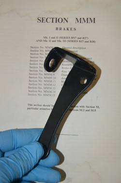 Brake line caliper bracket