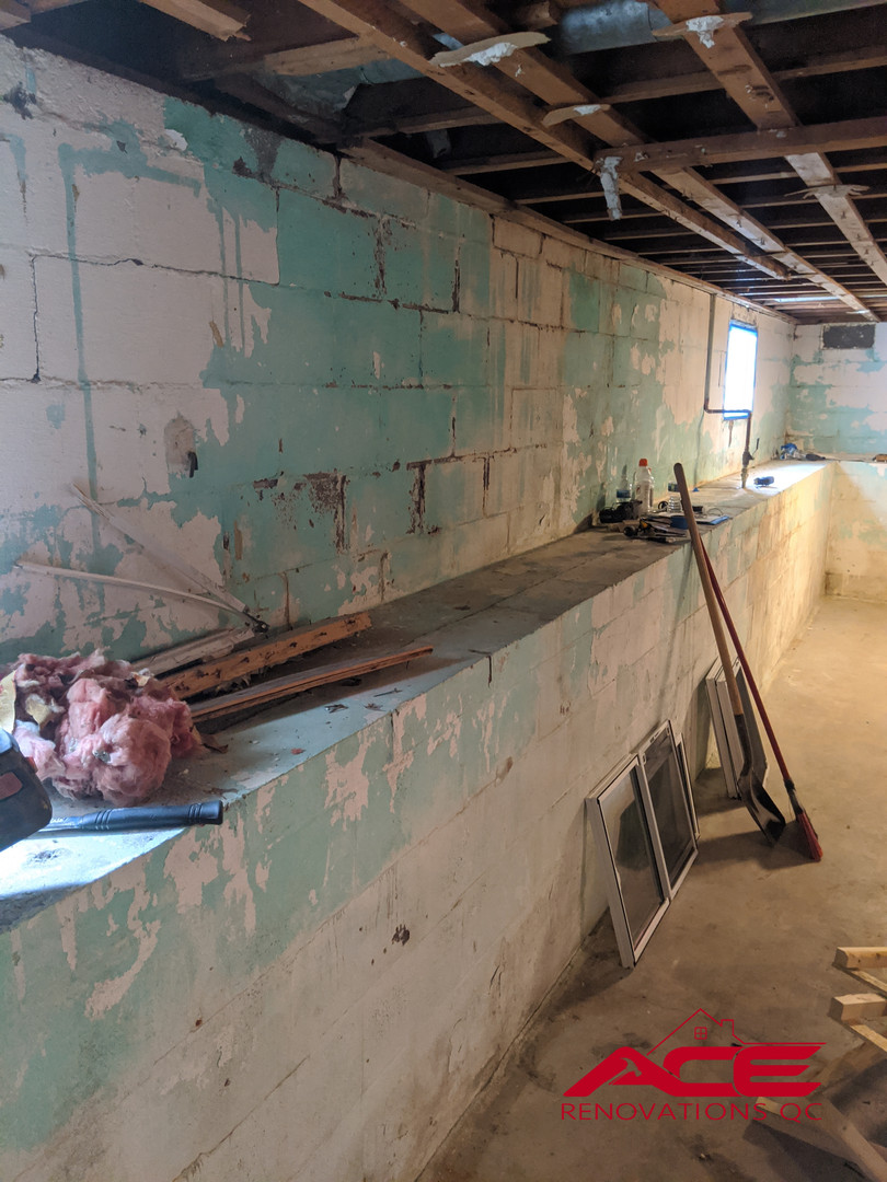 Before picture of a Drain Tile System Installation