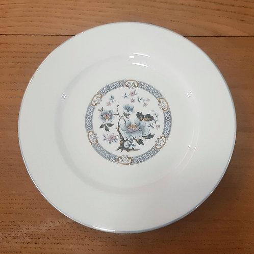 Assiette à  dessert en porcelaine  de Limoges