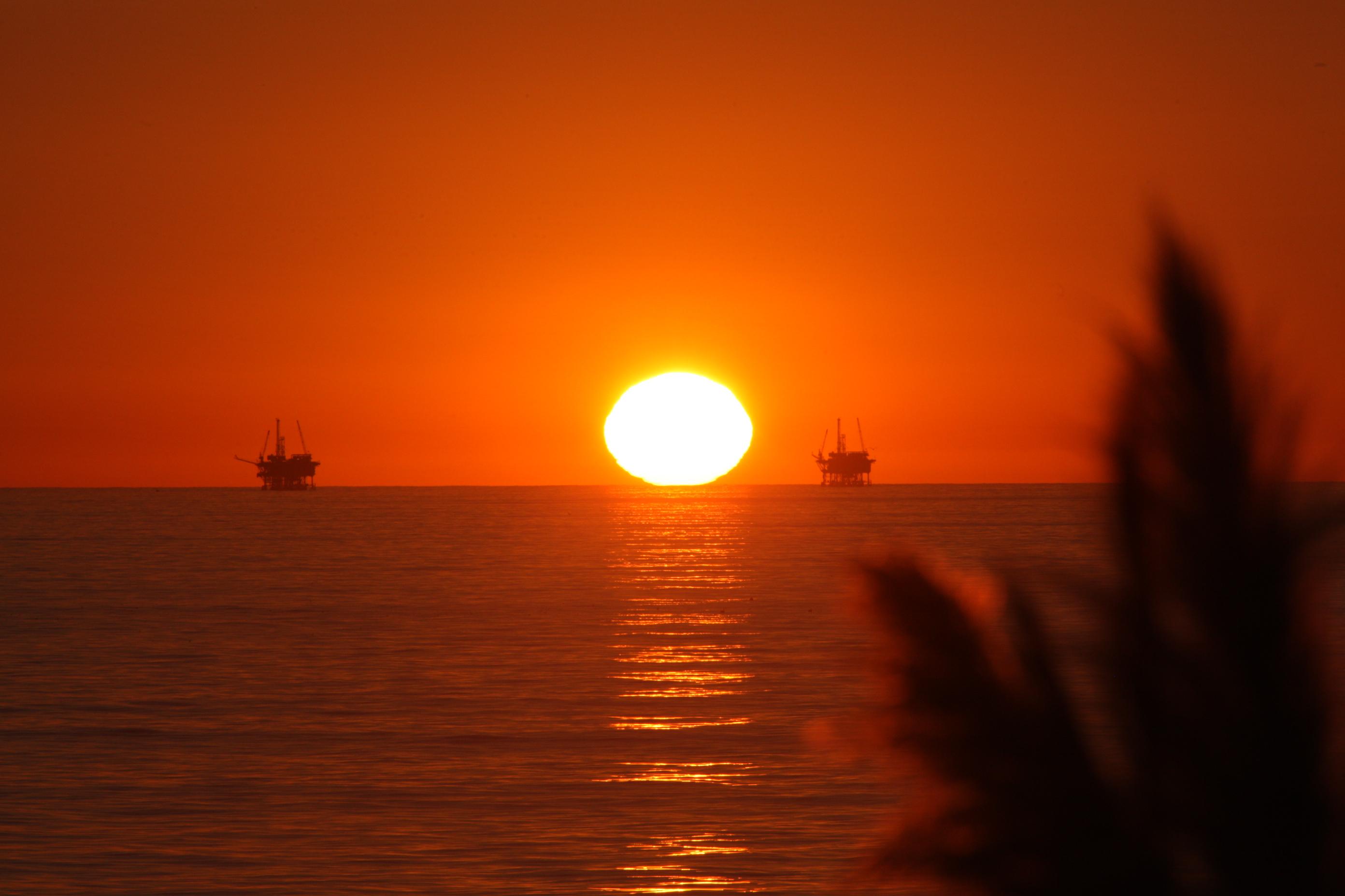Carp+Bluffs+Sunset+Oil+Platforms