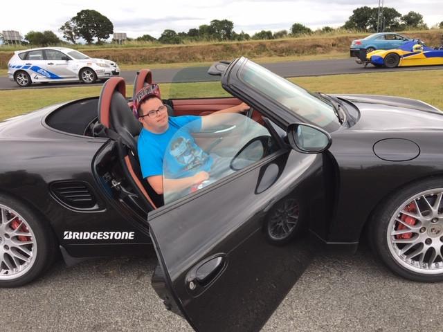 Jonny in a cool car