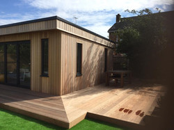 Cedar clad building, hardwood deck.