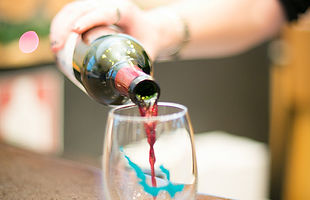Wine is poured into a Walloon Lake Glass