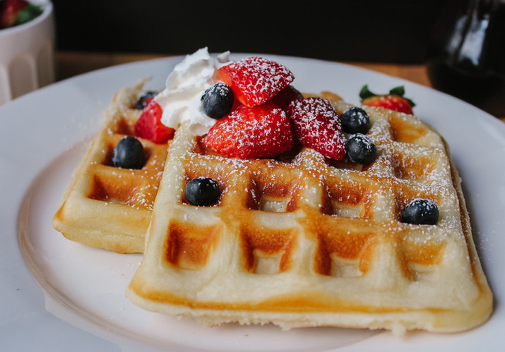 Homemade waffles with fresh fruit and whipped cream