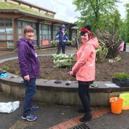 Maureen & Jen planning where plants go