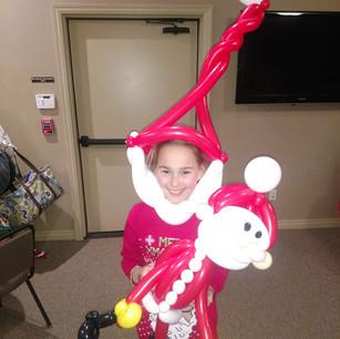 Girl with Christmas Balloons.jpg
