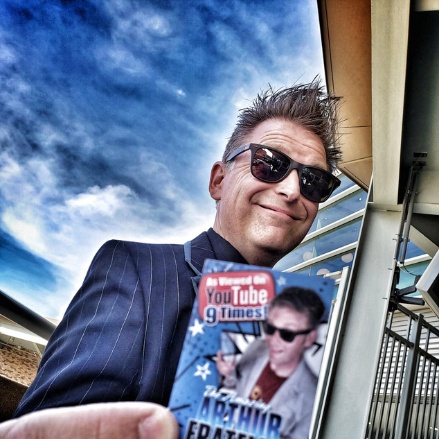Arthur Fratelli with Business Card at Cr