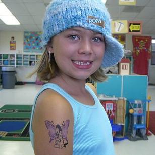 Girl with Tattoo on Arm.jpg