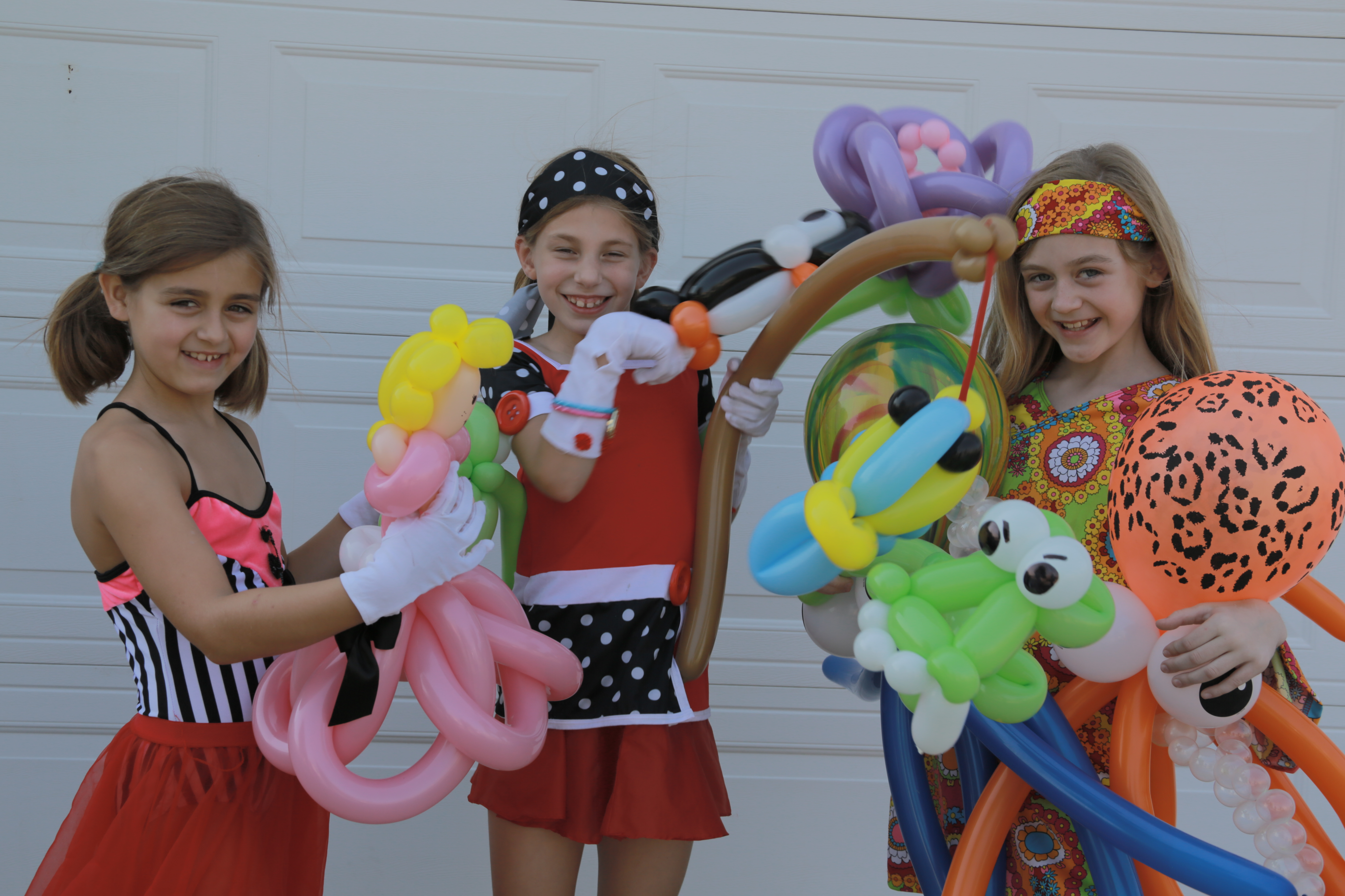 3 girls with balloon creations