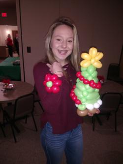 Girl with Christmas Tree Balloon