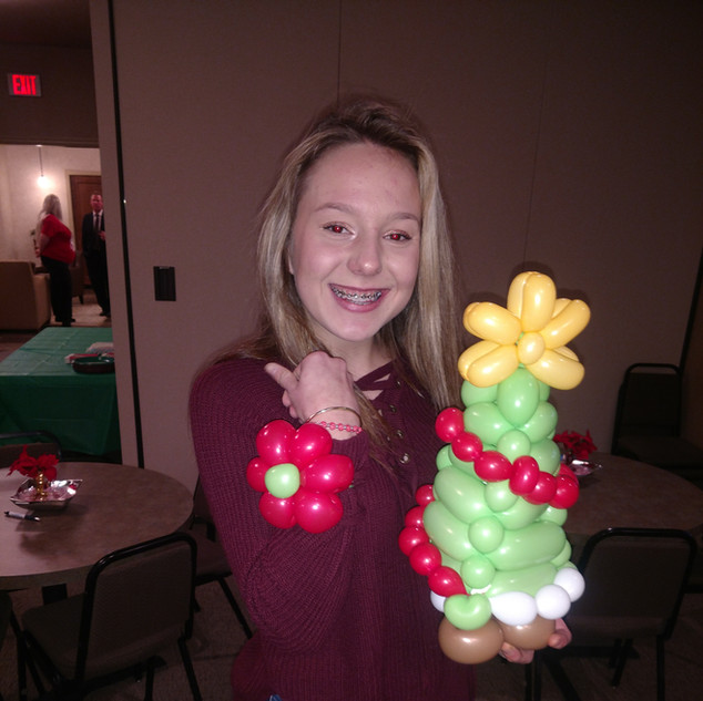 Girl with Christmas Tree Balloon.jpg