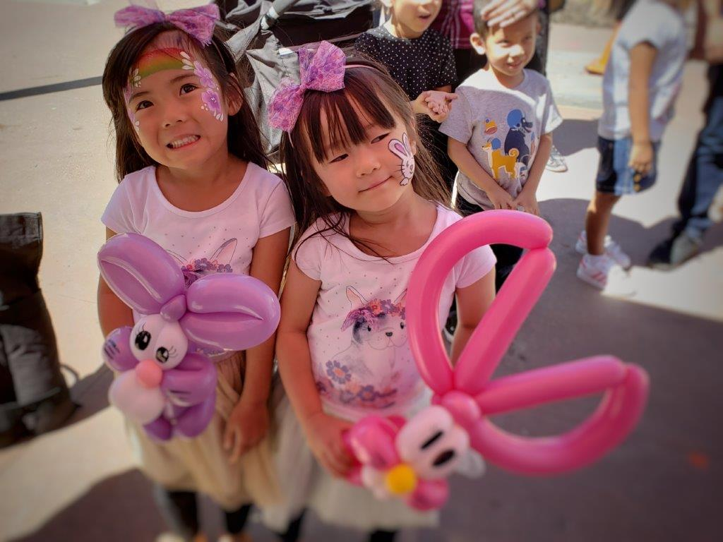 Twins with Balloon Bunny Rabbits