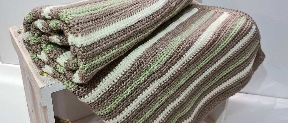 Green, brown and white striped baby blanket rolled