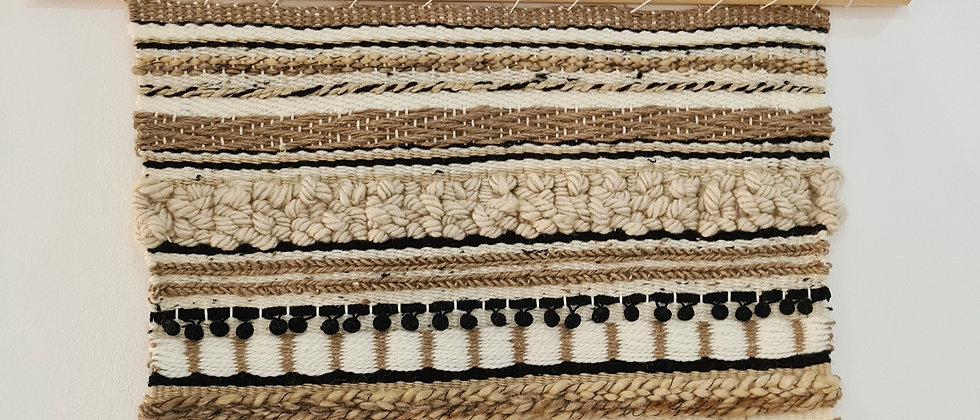 striped brown and black weaving wall hanging