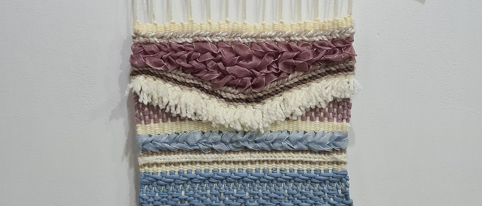 pink and blue weaving wall hanging