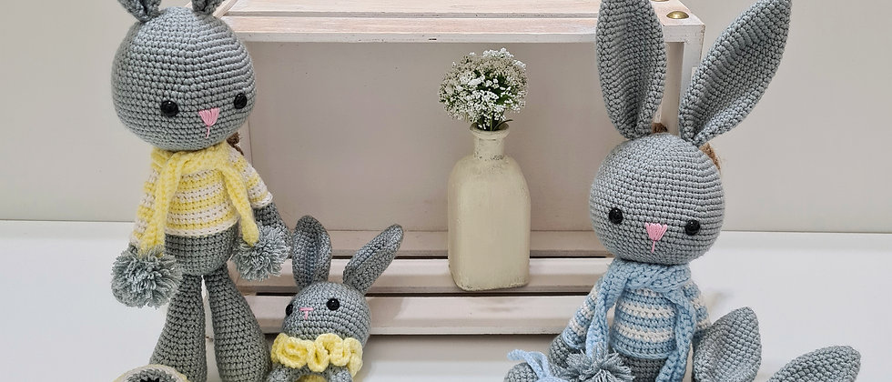 grey bunnies with blue and yellow shirts, matching rattles and evil eye wall hanging sets