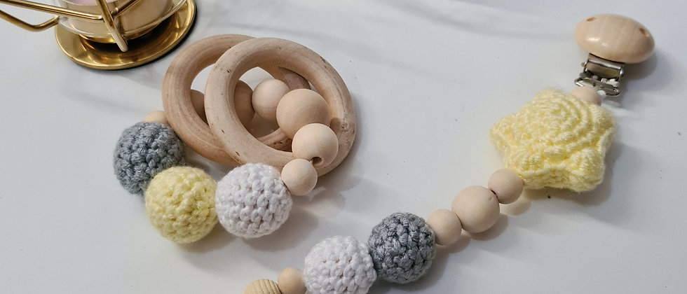 yellow star pacifier clip and wooden rattle set