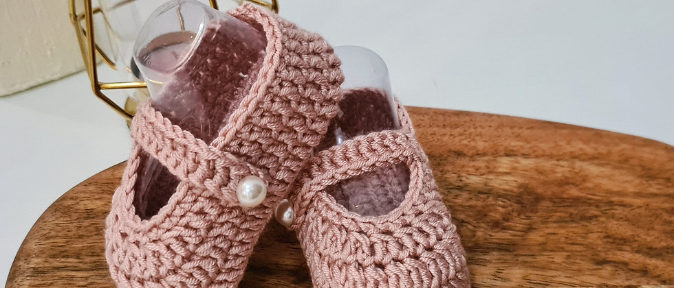 pink baby ballerina shoes posed