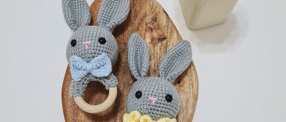 grey bunnies with blue and yellow rattles baby toys