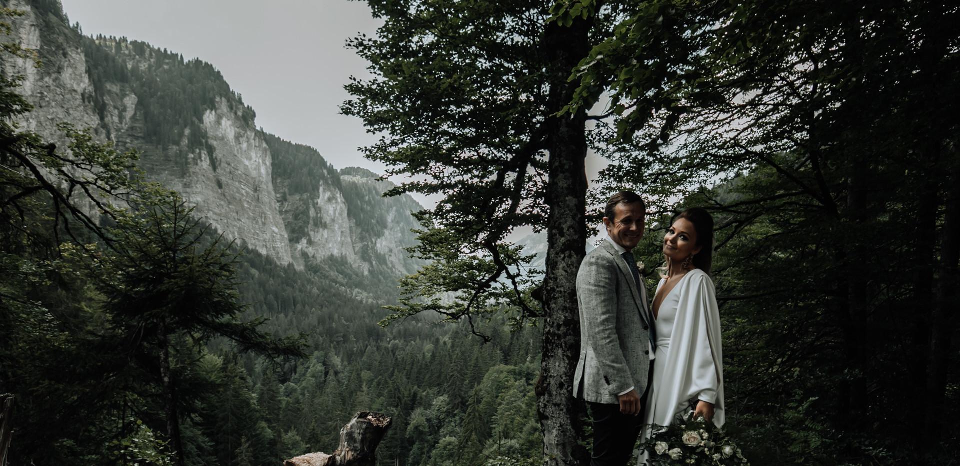Mountain top photo with wedding couple