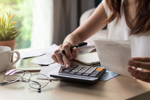 Stressed young woman checking bills, tax