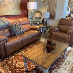 brown leather couch & wood coffee table.