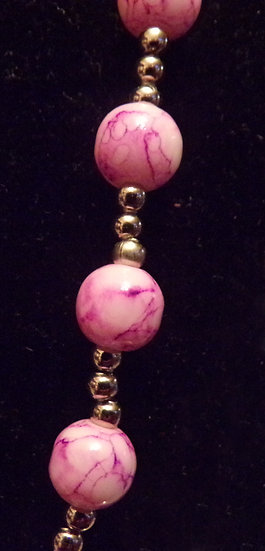 Pink swirl necklace and set.