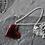 Thumbnail: Black enamel heart with red edges
