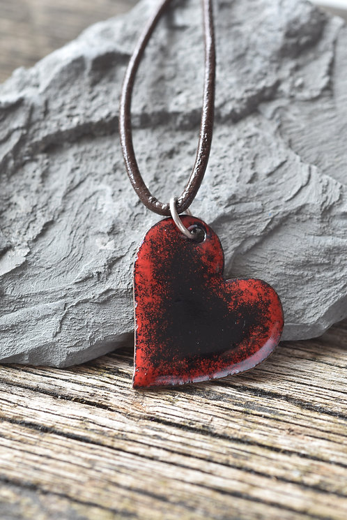 Black enamel heart with red edges