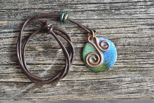 Curly copper and enamel pendant - green/blue