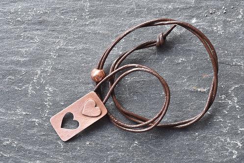 Two hearts copper pendant