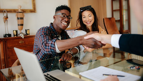 Happy property owners shaking hands with