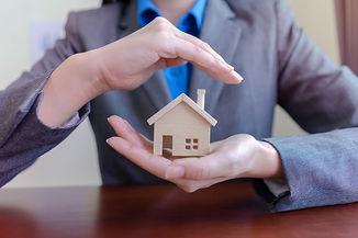 Real estate or Bank officer hands holdin