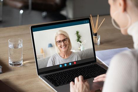 Back view of woman speak talk on video c