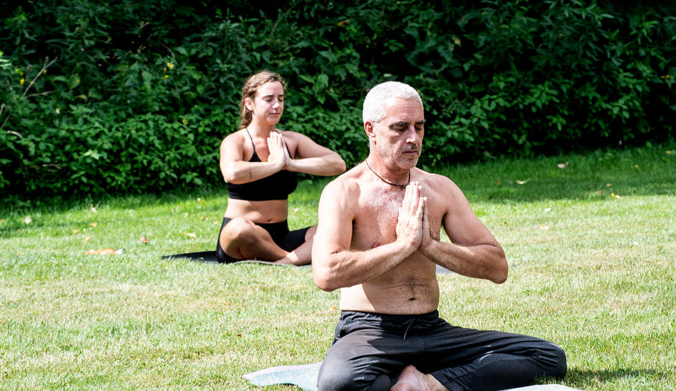 Outdoor yoga on the Featherbed meadow
