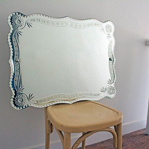 Miroir ancien ciselé