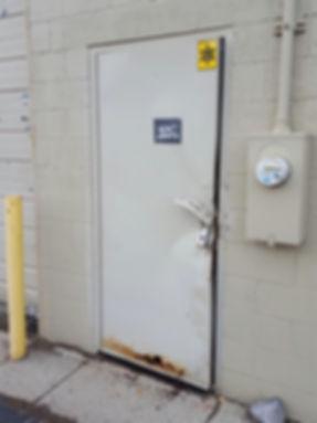 Damaged steel door