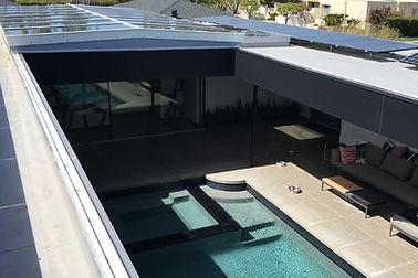 Retractable - low slope ridge skylight.j