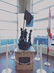 This 911 Memorial bronze sculpture was created by Artist Geoffrey C. Smith. It can be found in the Stuart Police Department in Stuart, Florida.