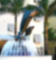 Blue Thunder, a bronze sculpture created by Artist Geoffrey C. Smith, shows a leaping sailfish in a fountain and is located in Stuart, Florida.