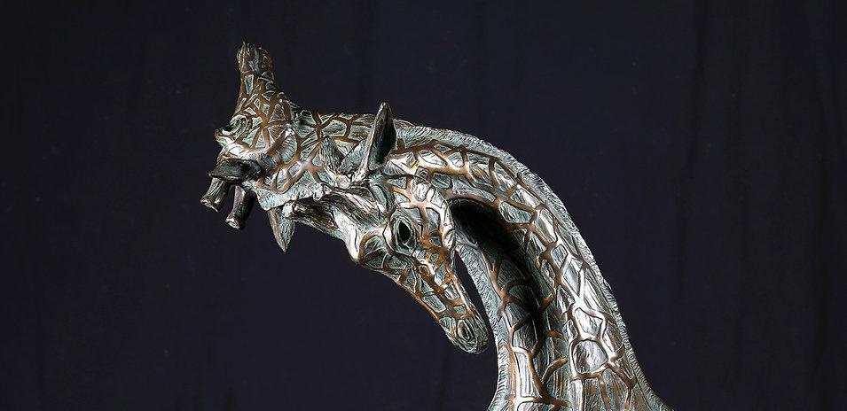 Close up of two Giraffe bronze sculputer by Artist Geoffrey C Smith.