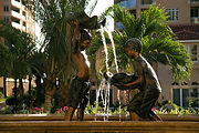 The Shell Boys, a bronze sculpture created by Geoffrey C. Smith, shows 2 boys with shells that transfers water to one another. This is located in Stuart, Florida.