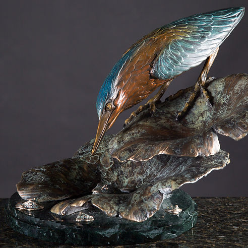 Sculptor Geoffrey C Smith's bronze sculpture of a Little Green Heron Feeding.