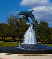 Life's Journey, a bronze sculpture created by Artist Geoffrey C. Smith, shows a pair of leaping dolphin and is located at Indian Riverside Park in Jensen Beach, Florida.