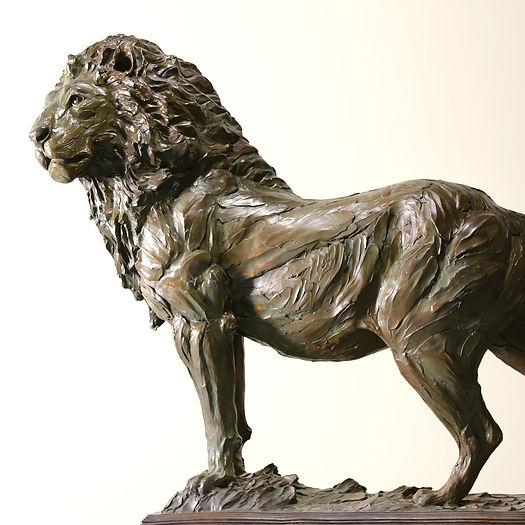 A bronze sculpture of a lion.