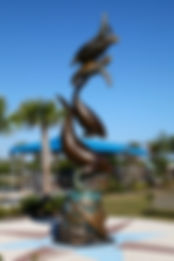 The Sea Life Monument, a bronze sculpture created by Artist Geoffrey C. Smith, displays swimming sea creatures stacked on one another. It is located at the Florida Oceanographic Society in Stuart, Florida.