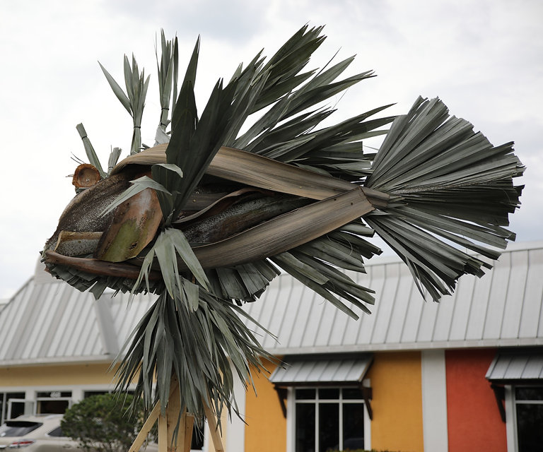 Geoffrey created a Lionfish made of palm fronds that he bound together and trimmed.
