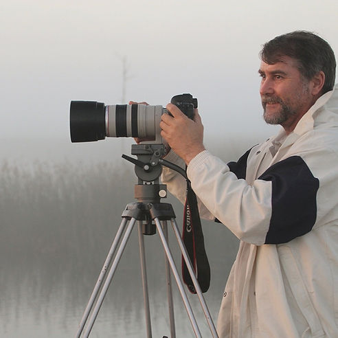 Photo of wildlife artist and photographer Geoffrey C Smith.