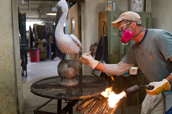 Pelican Sculpture During Patina Process at Foundry