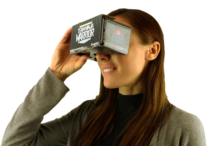 Girl looking into Branded VR box?